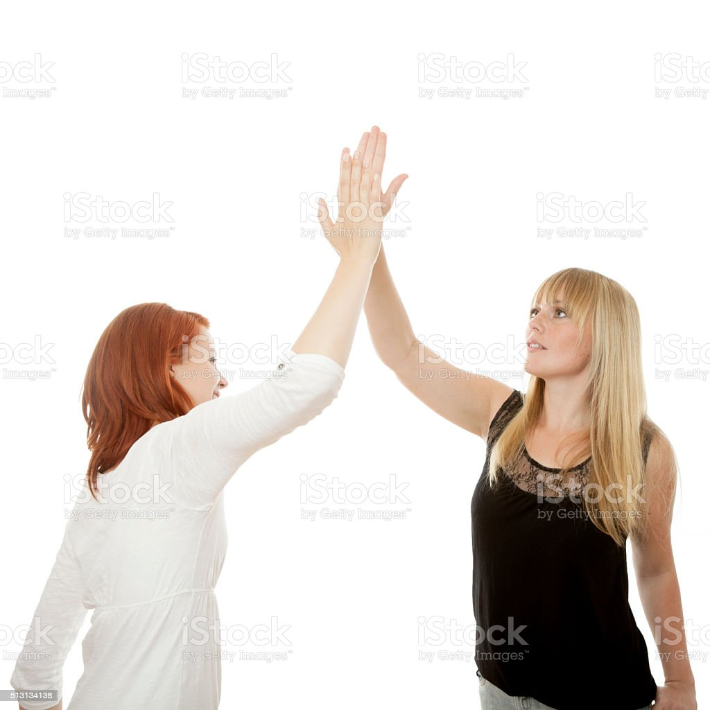 young beautiful red and blond haired girls give high five stock photo
