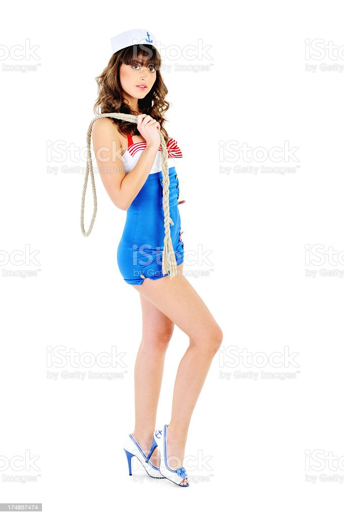 Young beautiful ship stewardess holding a rope royalty-free stock photo