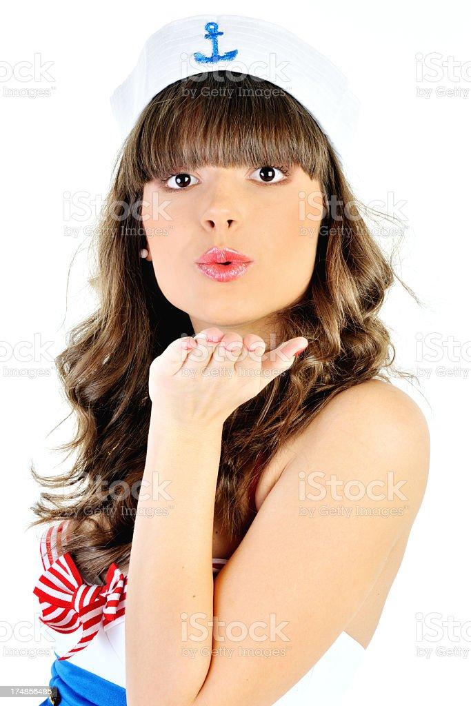 Young beautiful ship stewardess sending a kiss royalty-free stock photo