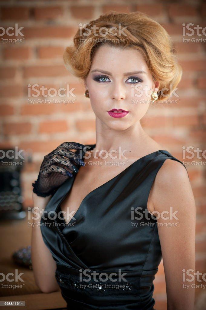 Young Beautiful Short Hair Blonde Woman In Black Dress Posing