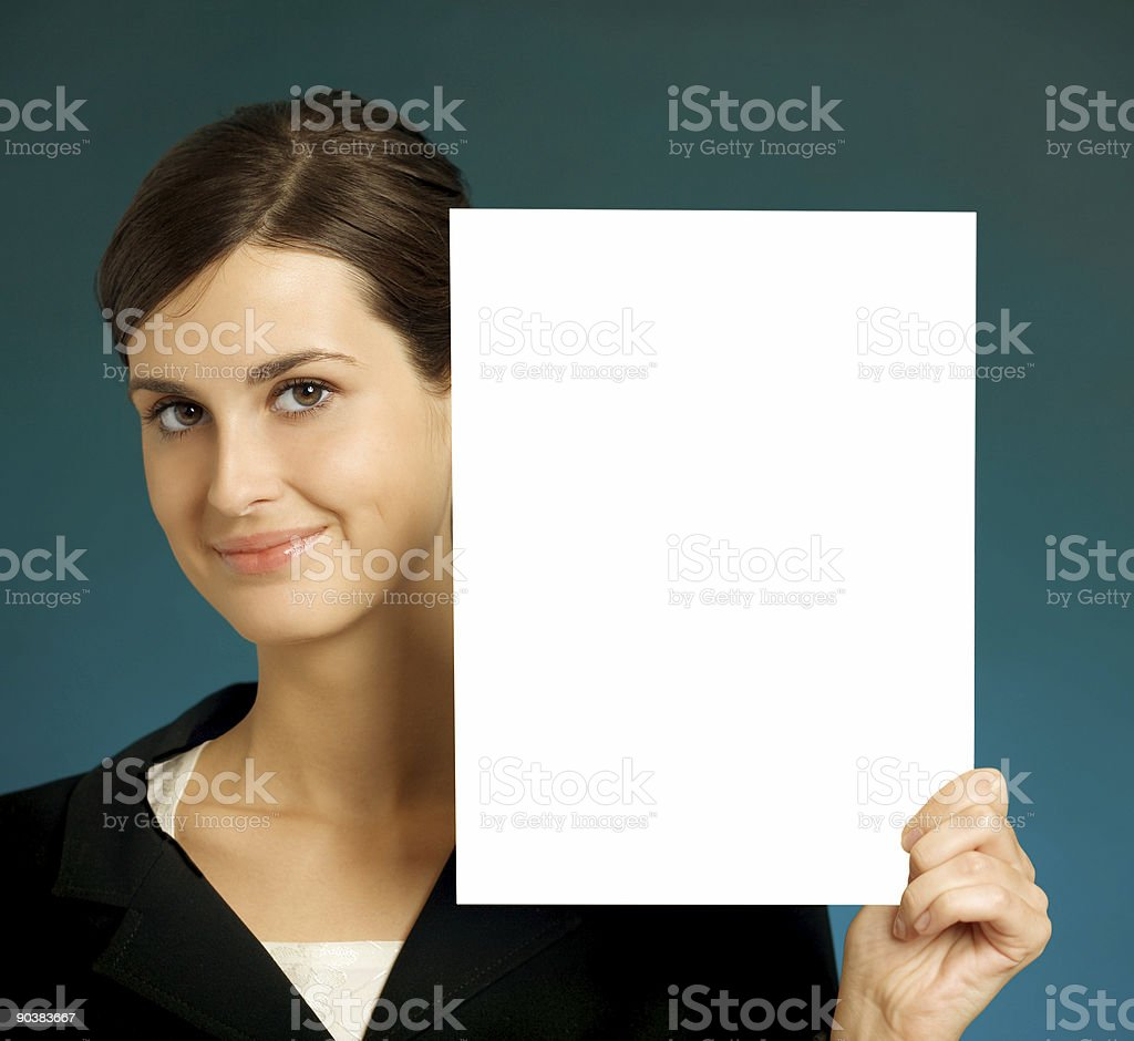 Young beautiful smiling student, secretary or businesswoman with sign royalty-free stock photo