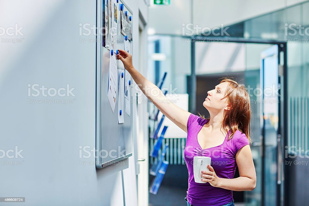 Young beautiful student at college or university stock photo