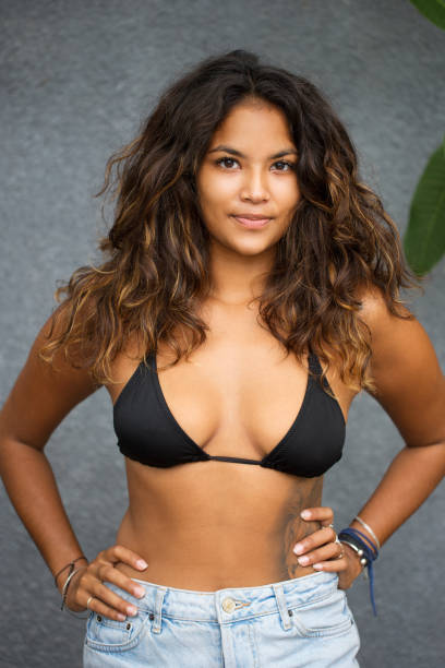 Young Beautiful Tanned Woman in Bra and Shorts stock photo