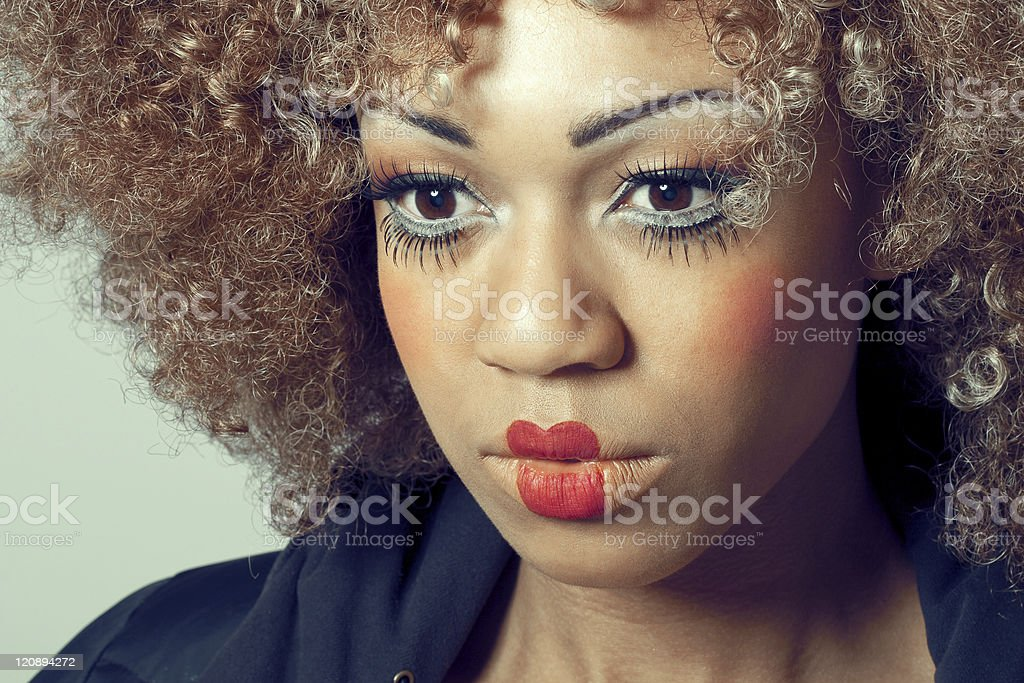 Young beautiful thoughtful woman with clown make-up royalty-free stock photo