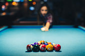 istock Young beautiful woman and plays billiard and have fun. 1134534379
