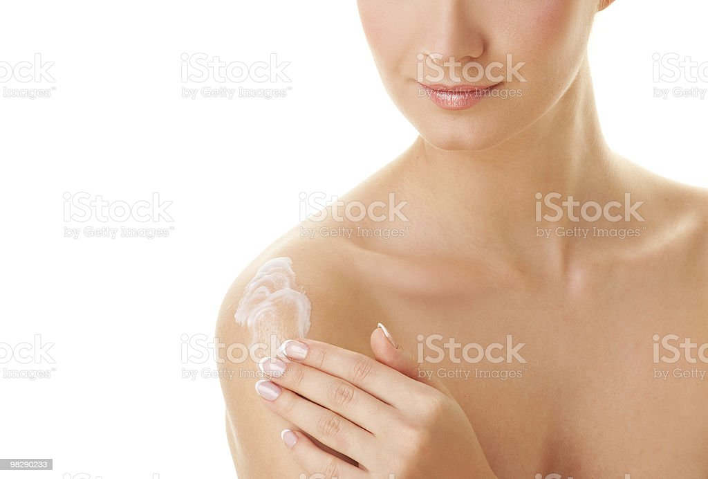 Young beautiful woman applying moisturizer to her skin after sho royalty-free stock photo