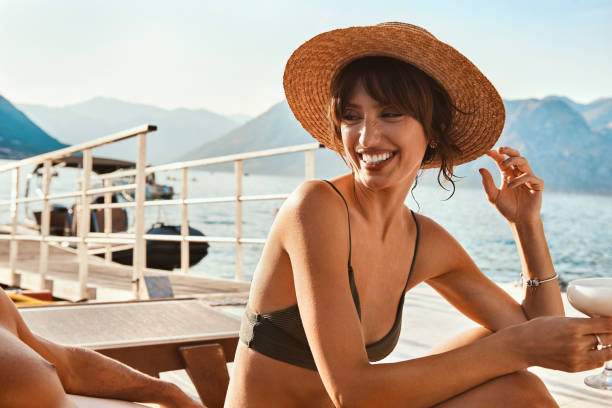 young beautiful woman are relaxing by the sea stock photo