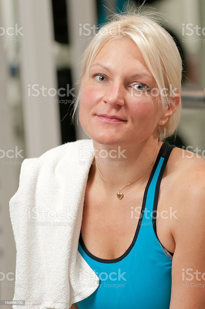 Young beautiful woman at the gym stock photo