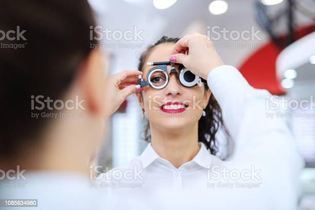 Young beautiful woman checking her sight at ophthalmologist on eyes picture id1085634980?b=1&k=6&m=1085634980&s=612x612&h=wmuybncyfg8h9l73 zzm21 6qbobeq1 hb1gsh1ecrw=