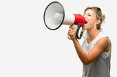 istock Young beautiful woman communicates shouting loud holding a megaphone, expressing success and positive concept, idea for marketing or sales 1042437478