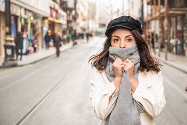 Cтоковое фото Young beautiful woman covering face with woolen scarf.