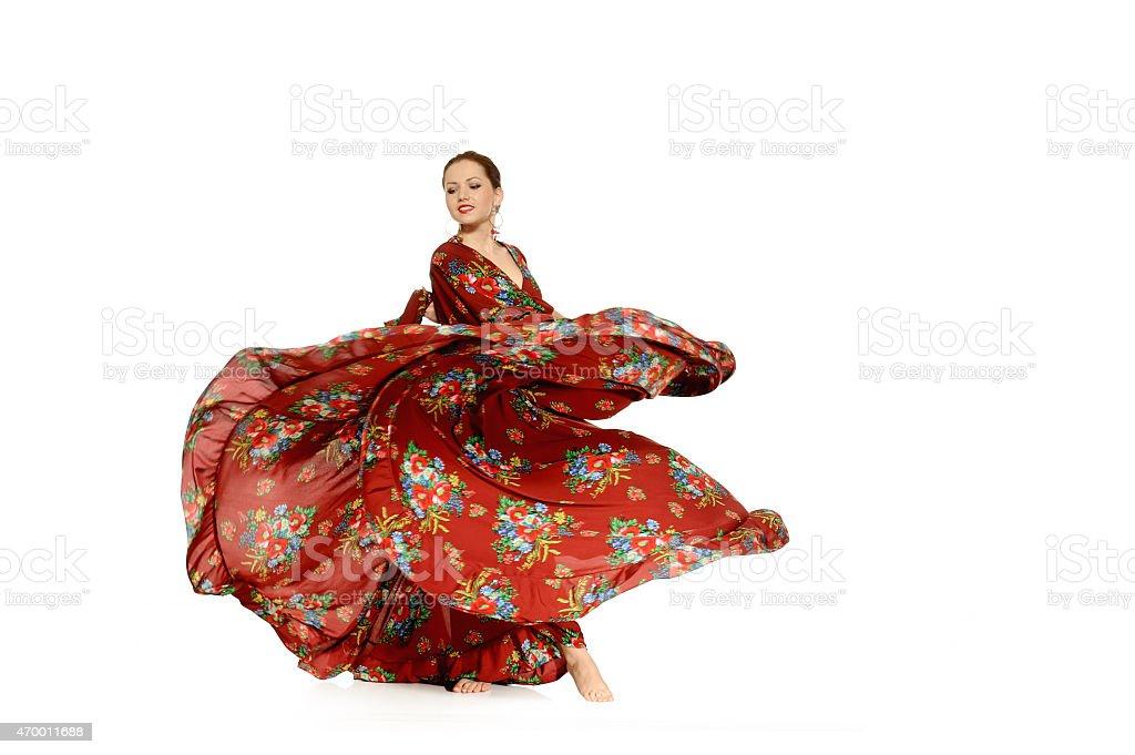 Young beautiful woman dancing gypsy dance stock photo