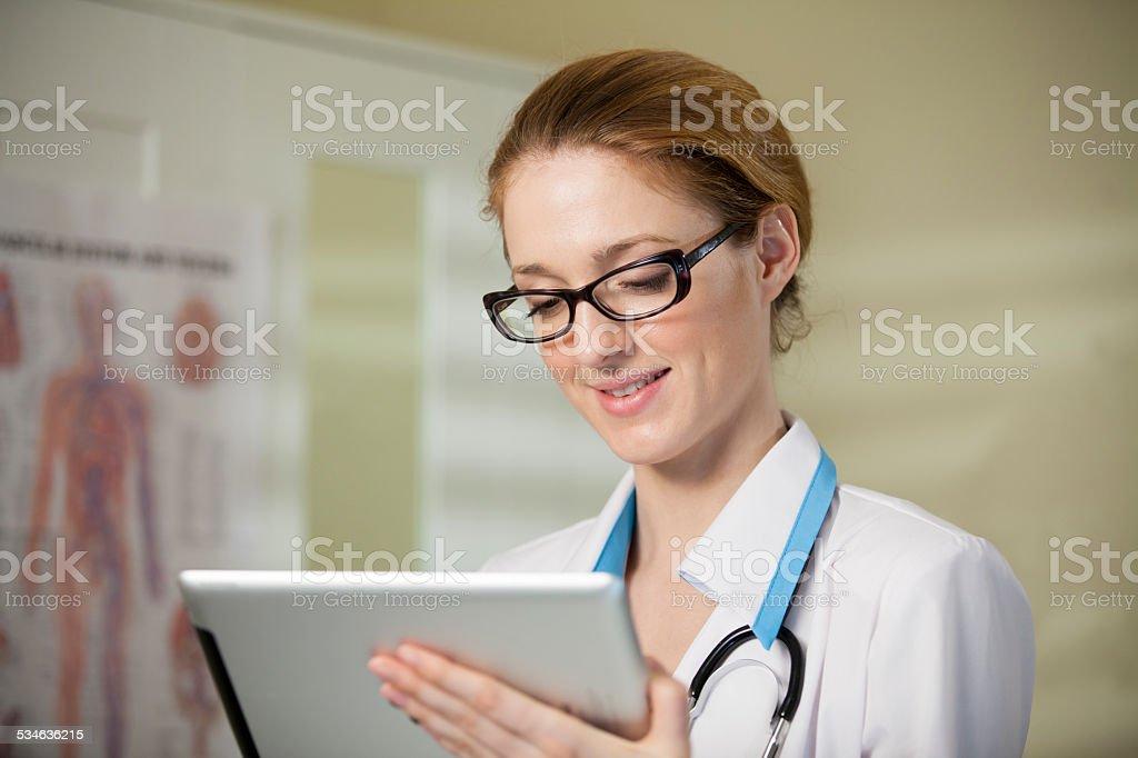 Young beautiful woman doctor stock photo