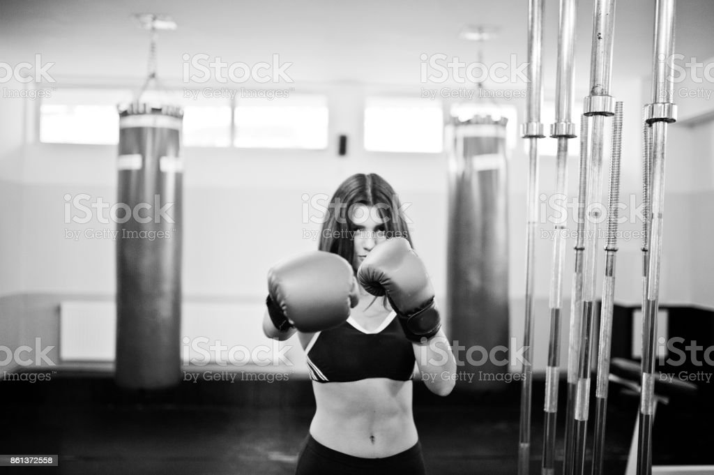 Young beautiful woman doing exercises  and working hard in gym and enjoying her training process. stock photo