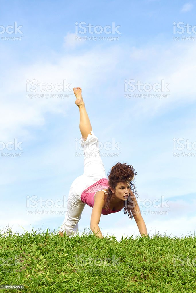 Young Beautiful Woman Doing Yoga royalty-free stock photo