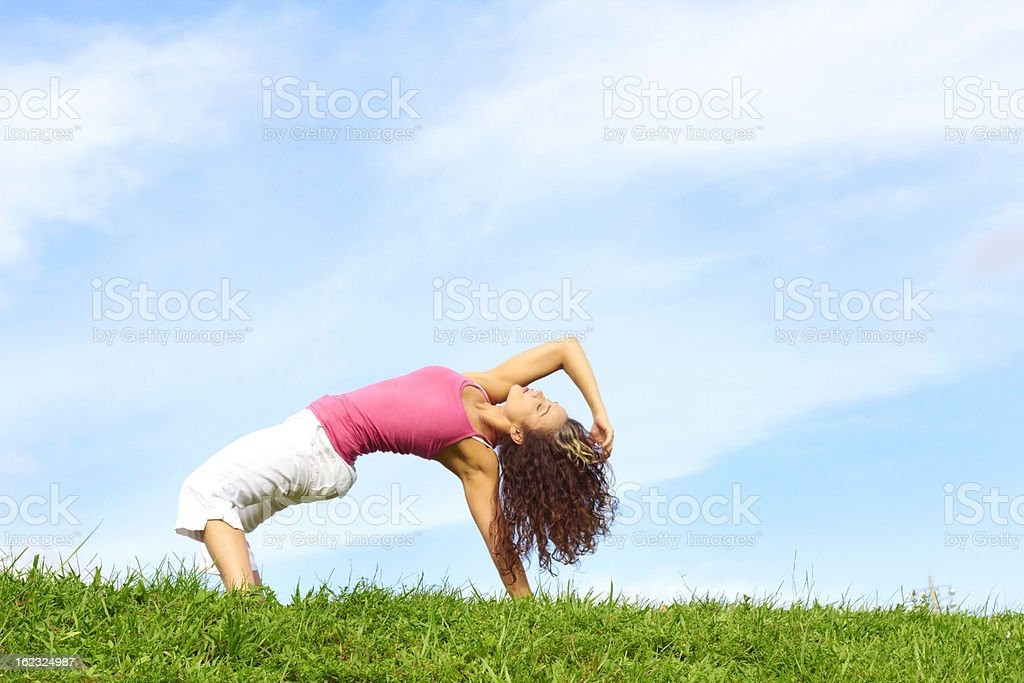 Young Beautiful Woman Doing Yoga royalty-free stock photo