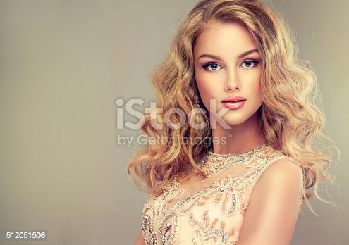 istock Young beautiful woman, dressed in evening gown. 512051506