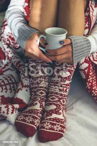 young beautiful woman drinking hot coffee