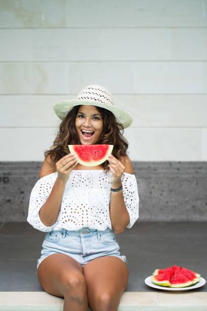 Young Beautiful Woman Eating Watermelon stock photo