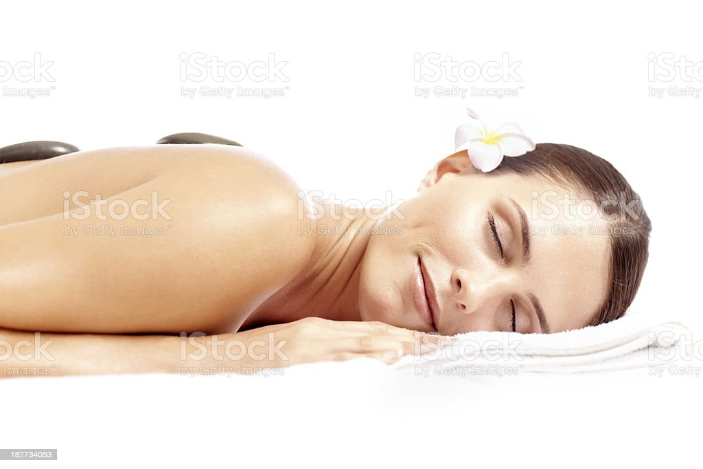 Young beautiful woman enjoying la stone therapy royalty-free stock photo