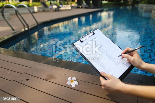 istock young beautiful woman fills out visa application form for Europe 930319922
