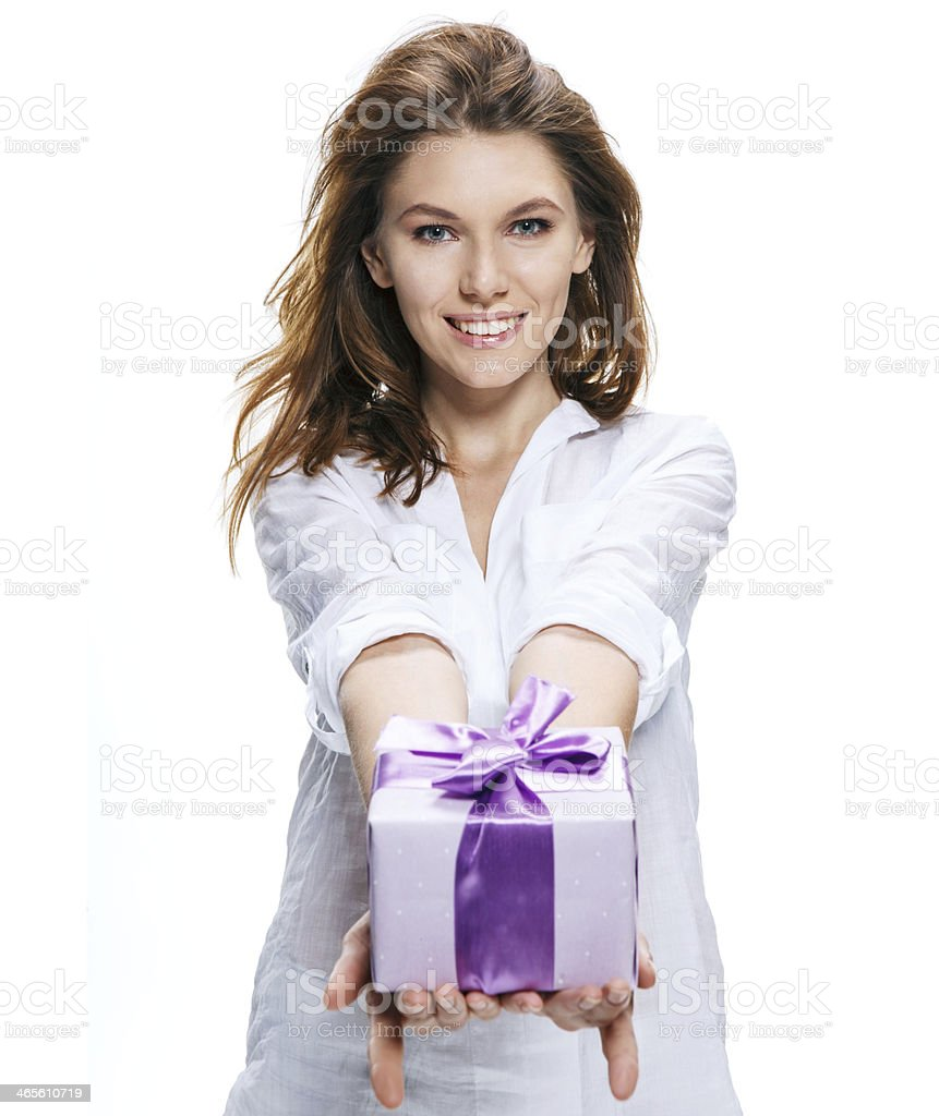 Young beautiful woman gives gift in box isolated on white stock photo