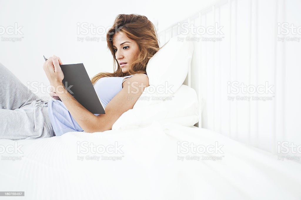 Young beautiful woman happy and positive resting in bed. royalty-free stock photo
