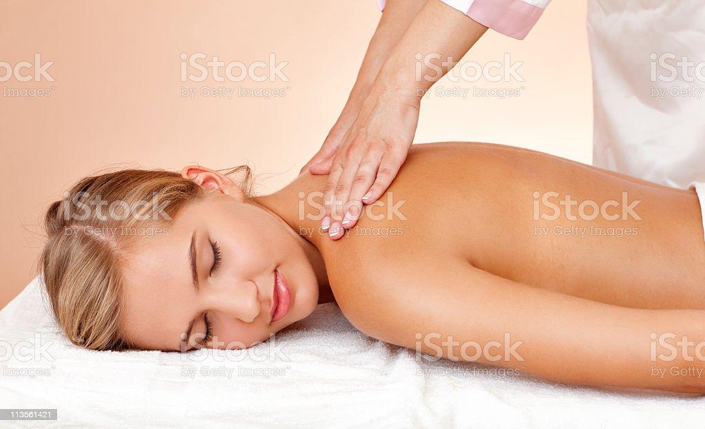Young beautiful woman having body treatment stock photo