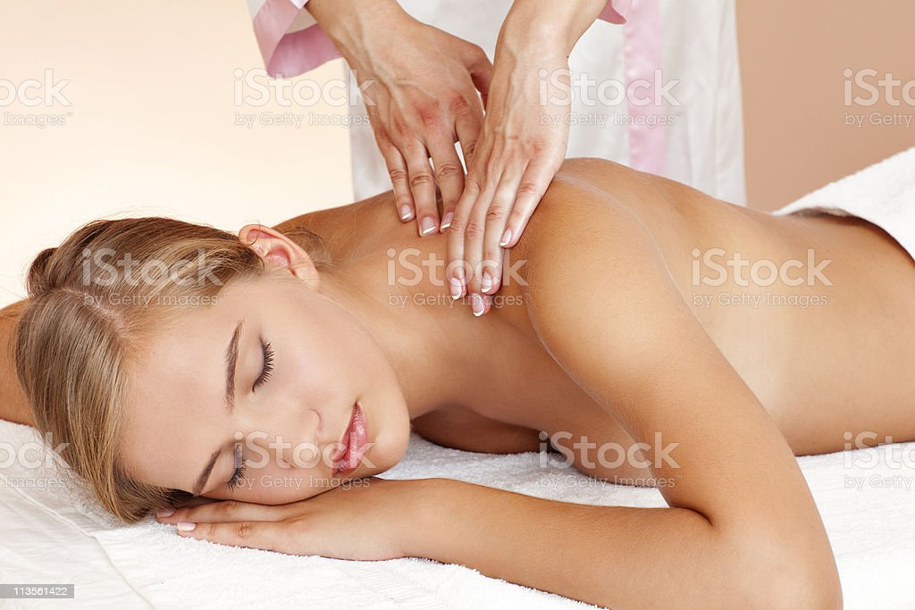 Young beautiful woman having body treatment royalty-free stock photo