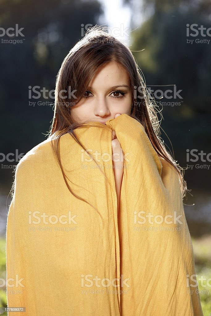 young beautiful woman hiding her face royalty-free stock photo
