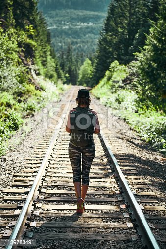 Shoot of young beautiful woman hiking in the forest