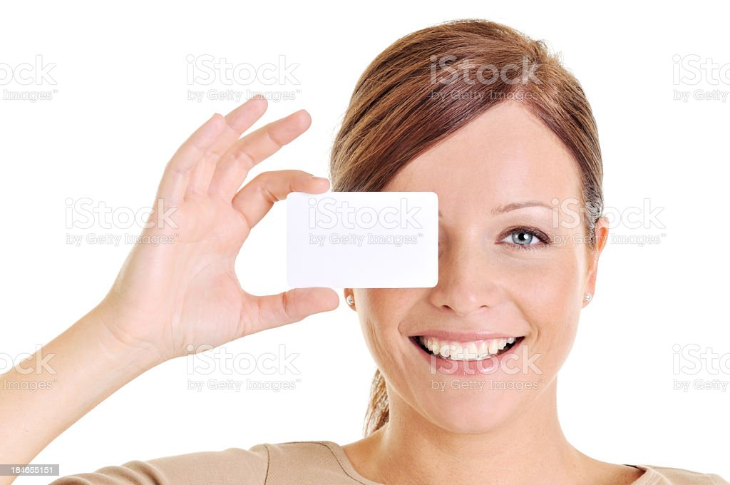 Young beautiful woman holding a blank business card royalty-free stock photo