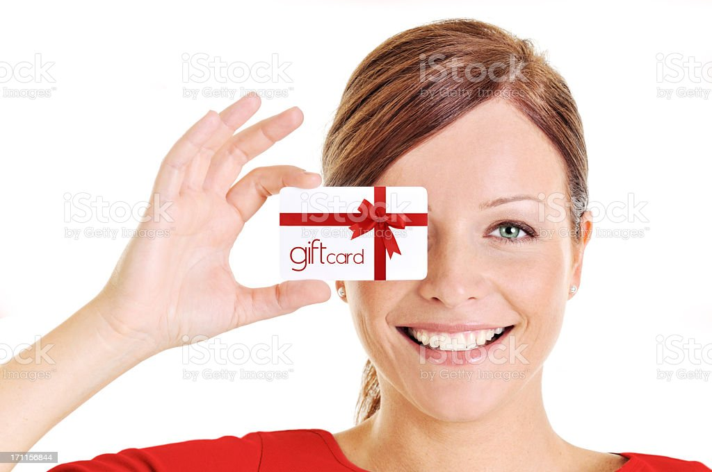Young beautiful woman holding a gift card royalty-free stock photo