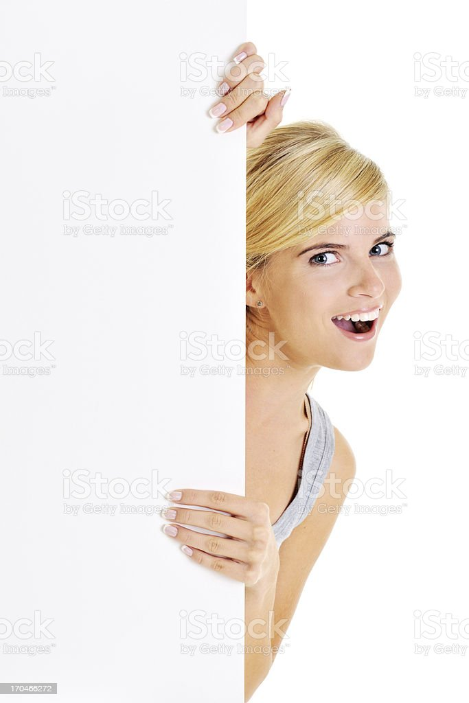 Young beautiful woman holding a white board royalty-free stock photo
