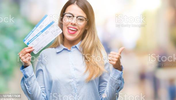 Young beautiful woman holding boarding pass over isolated background picture id1079877508?b=1&k=6&m=1079877508&s=612x612&h=ofarl2muphqzeeoq ubqmdkydgwnkh9iaaxhqmrgdfg=