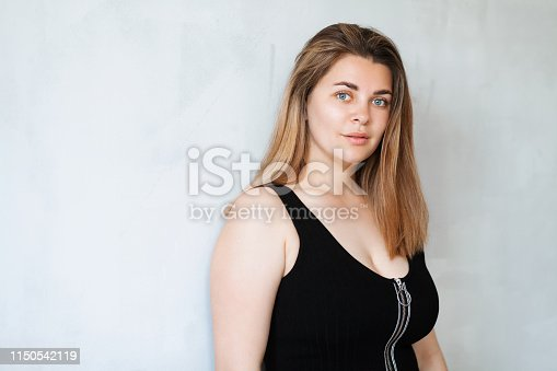 istock Young beautiful woman in black outfit 1150542119