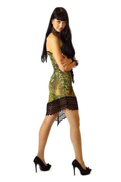 Young beautiful woman in cocktail dress. stock photo