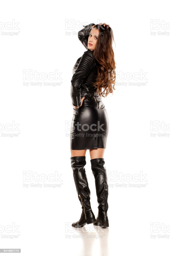 più alla moda migliore prodotto caldo Young Beautiful Woman In Leather Jacket Boots And Skirt Stock ...