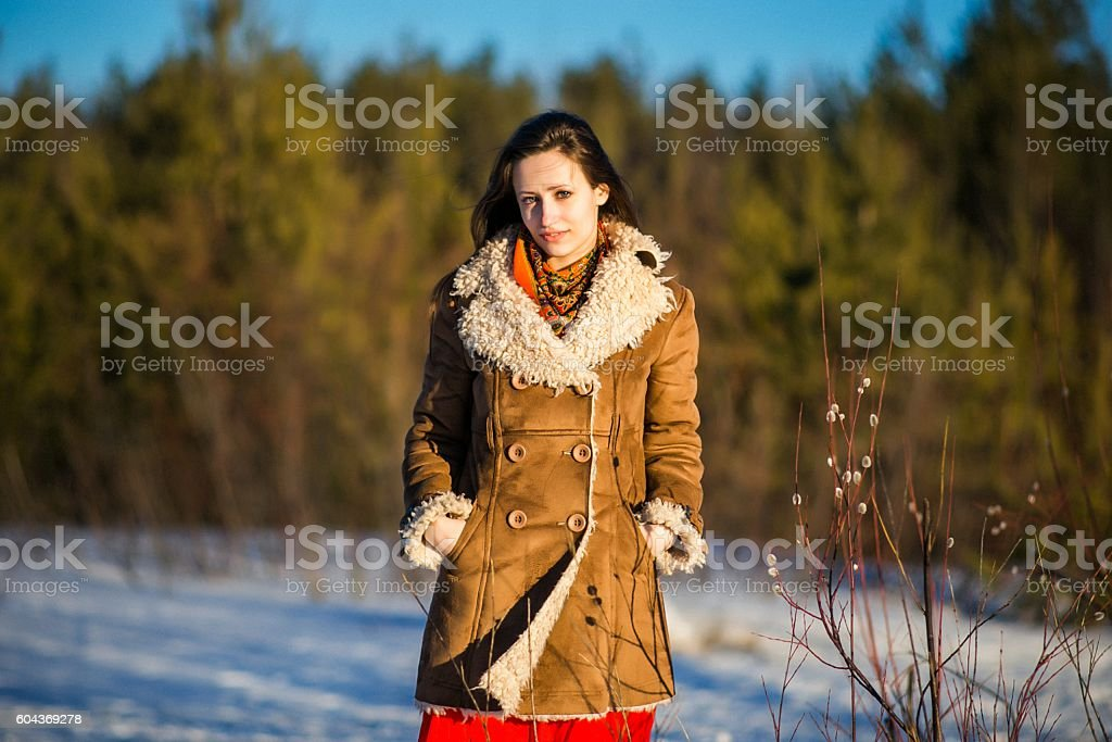 young beautiful woman in national ukraine suite at snowy winter stock photo
