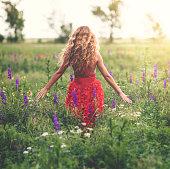 Young beautiful woman in poppy field