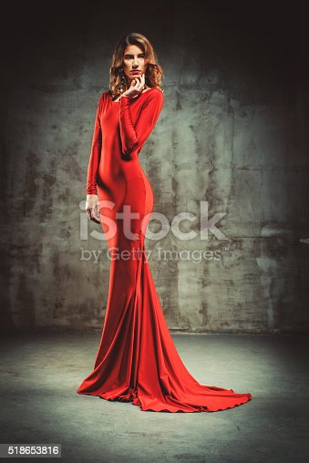 Full body shot of young beautiful woman in red dress