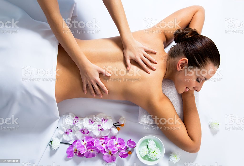 Young beautiful woman in spa environment stock photo