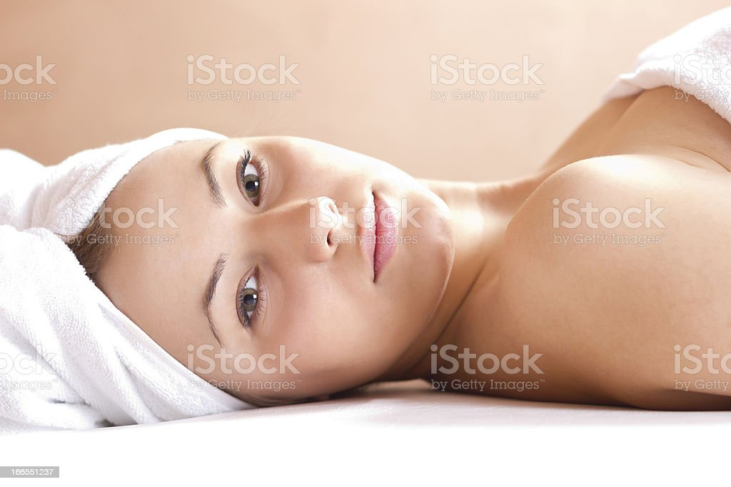 Young beautiful woman in spa royalty-free stock photo