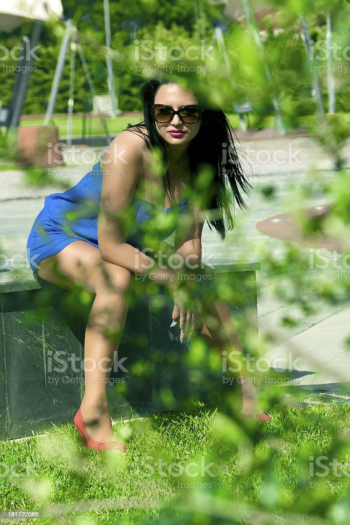 young beautiful woman in the park royalty-free stock photo
