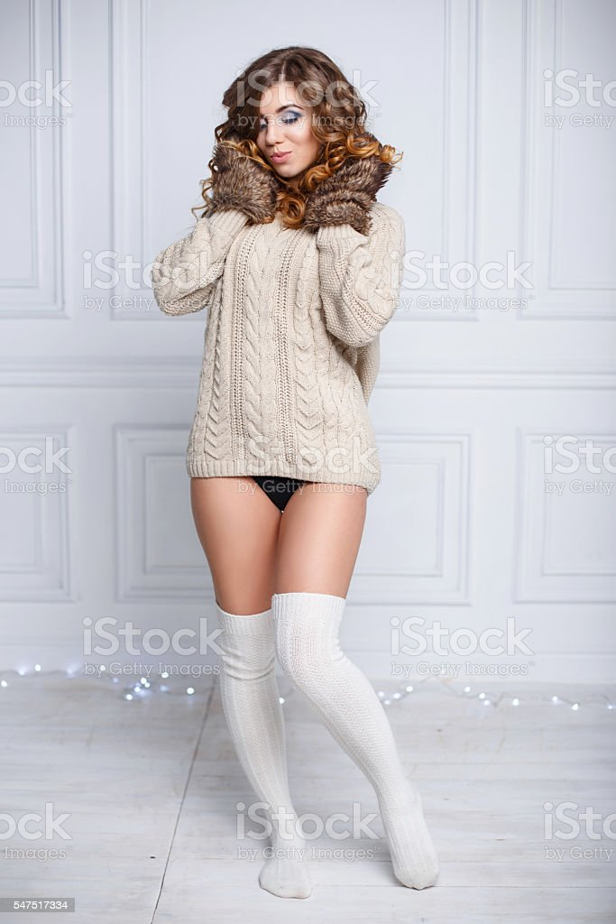 Young beautiful woman in winter warm clothes stock photo