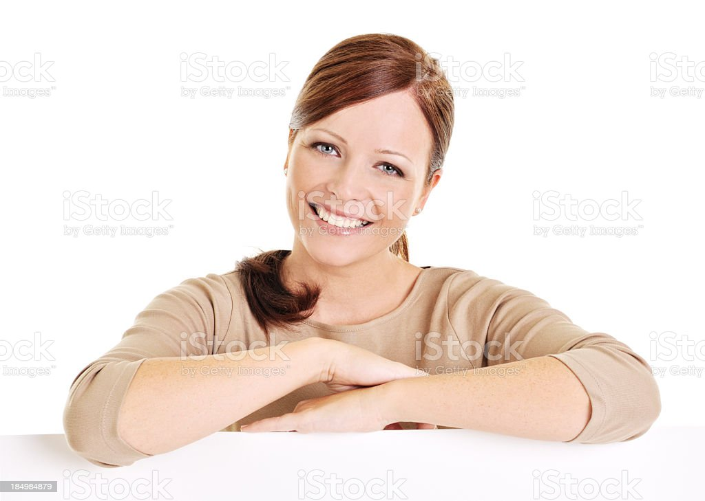 Young beautiful woman leaning on billboard royalty-free stock photo