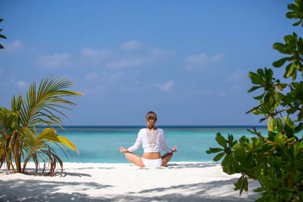 https://media.istockphoto.com/photos/young-beautiful-woman-meditation-on-beach-maldives-picture-id810165226?k=6&m=810165226&s=612x612&w=0&h=kcx7erF4XuqLSTZag5NulJafDXOrDsPRWX45iv9_4Qo=