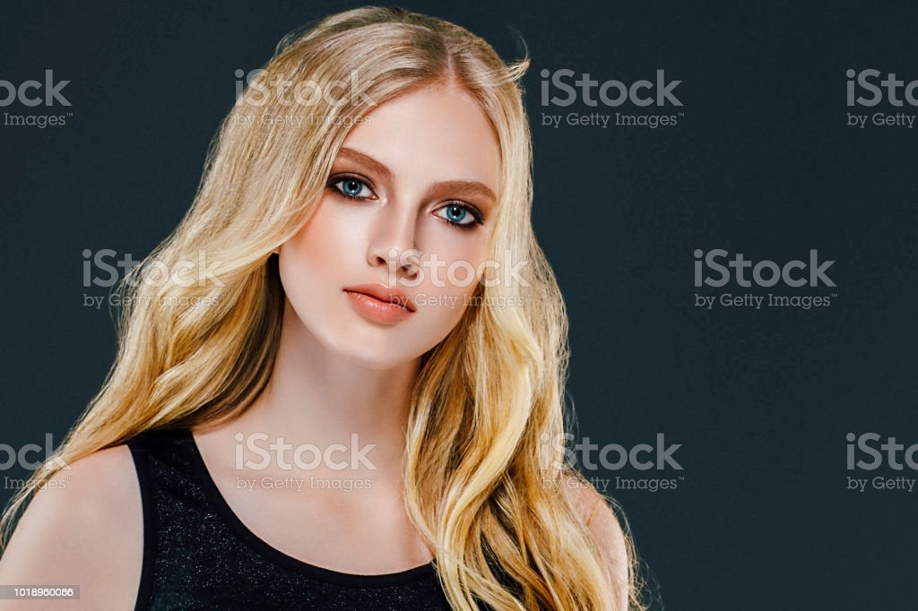 Young Beautiful Woman Model With Long Beauty Blonde Curly Hair