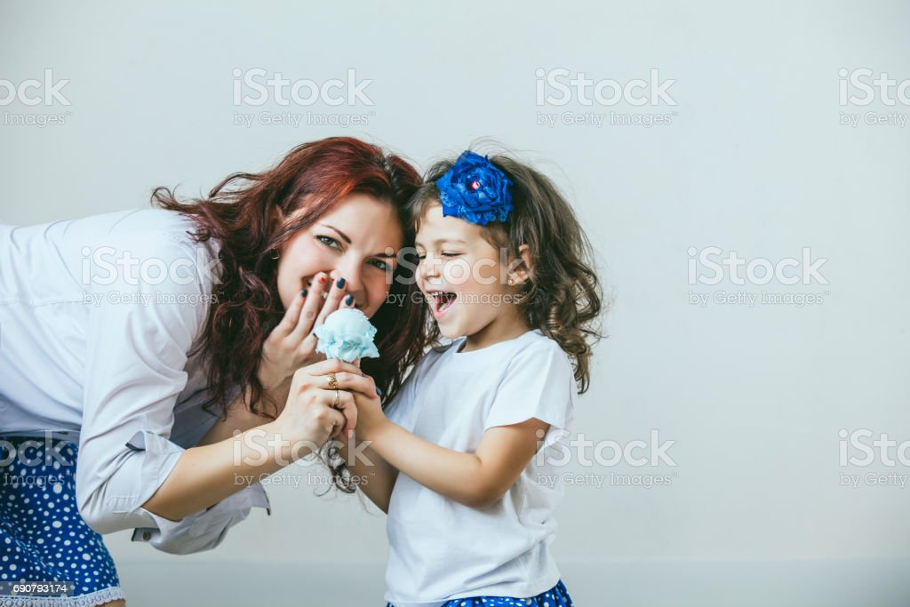 Young beautiful woman mother and daughter with toy a sweet happy portraits stock photo