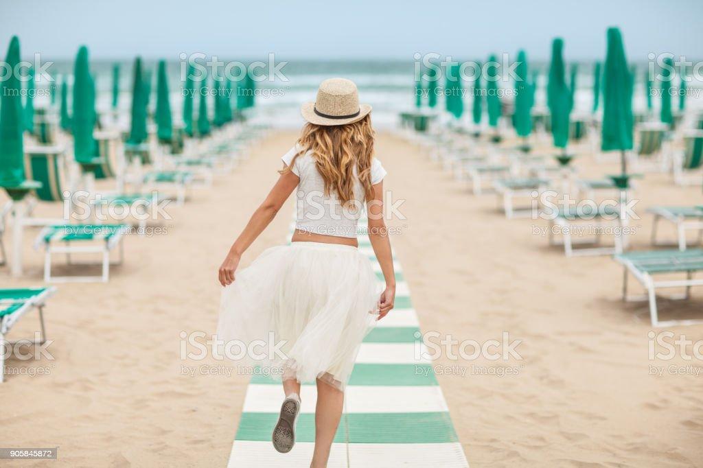 Young beautiful woman on beach stock photo